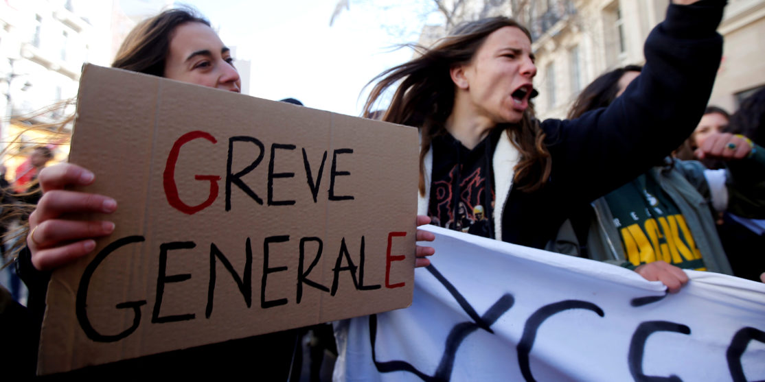 Protestors attend a demonstration during a national day of strike against reforms in Marseille