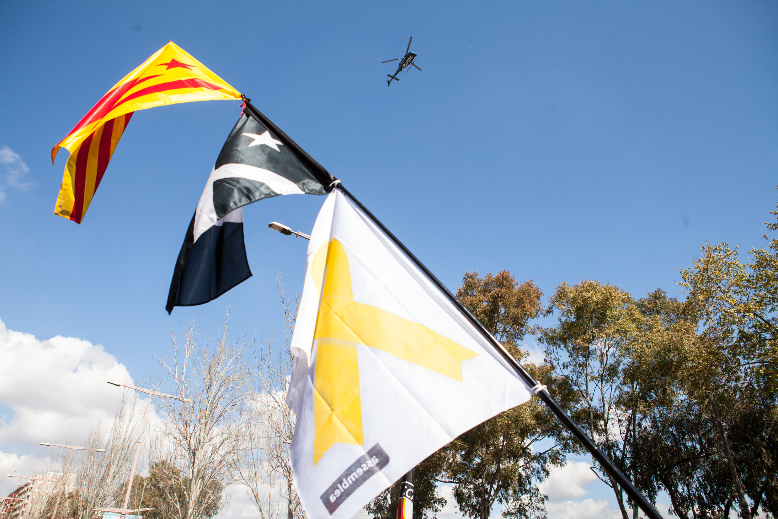 Catalan police watching  protesters from the elicopter. Barcelona