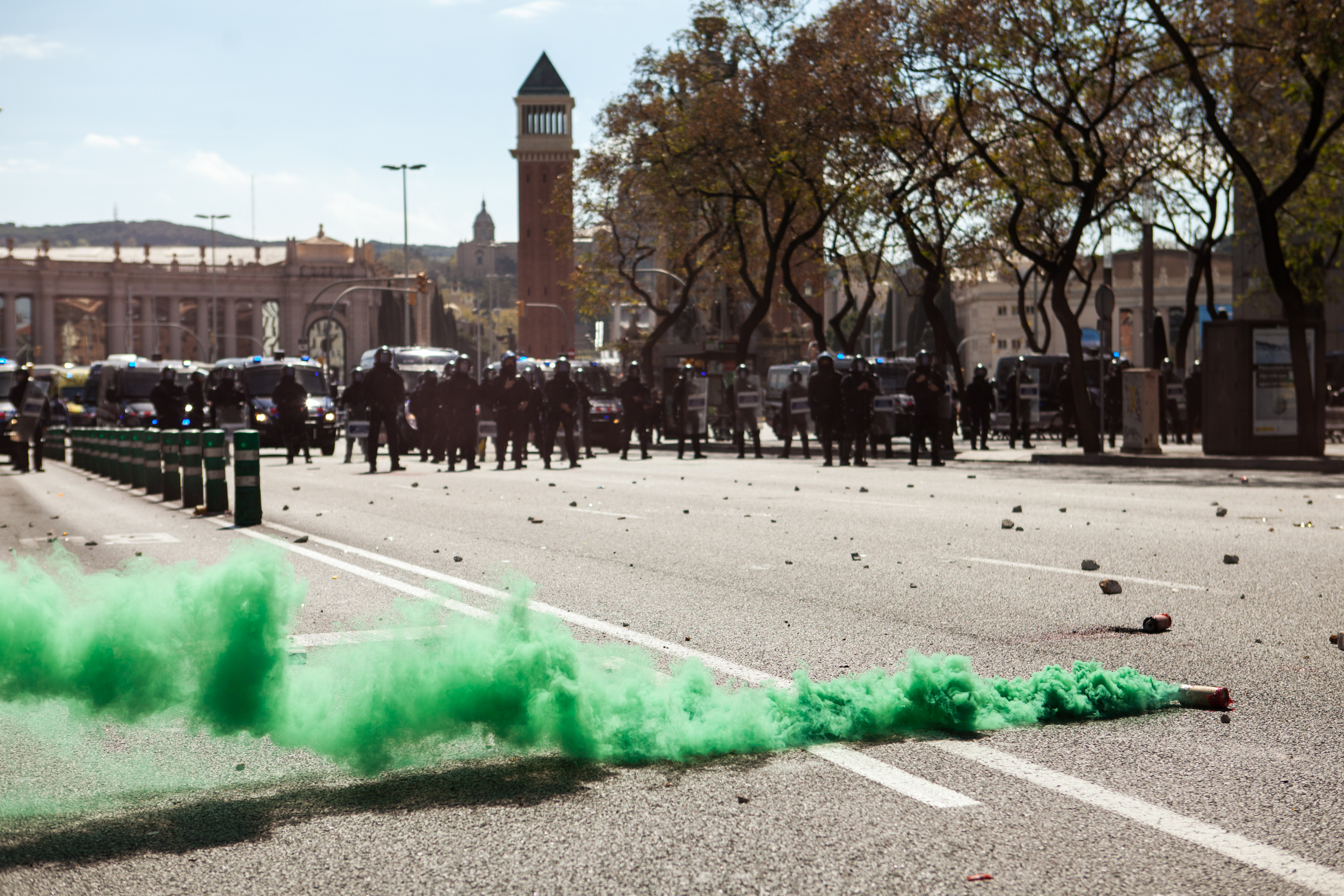 Antifascists throw stones to police trying to rich the far righ party. Barcelona