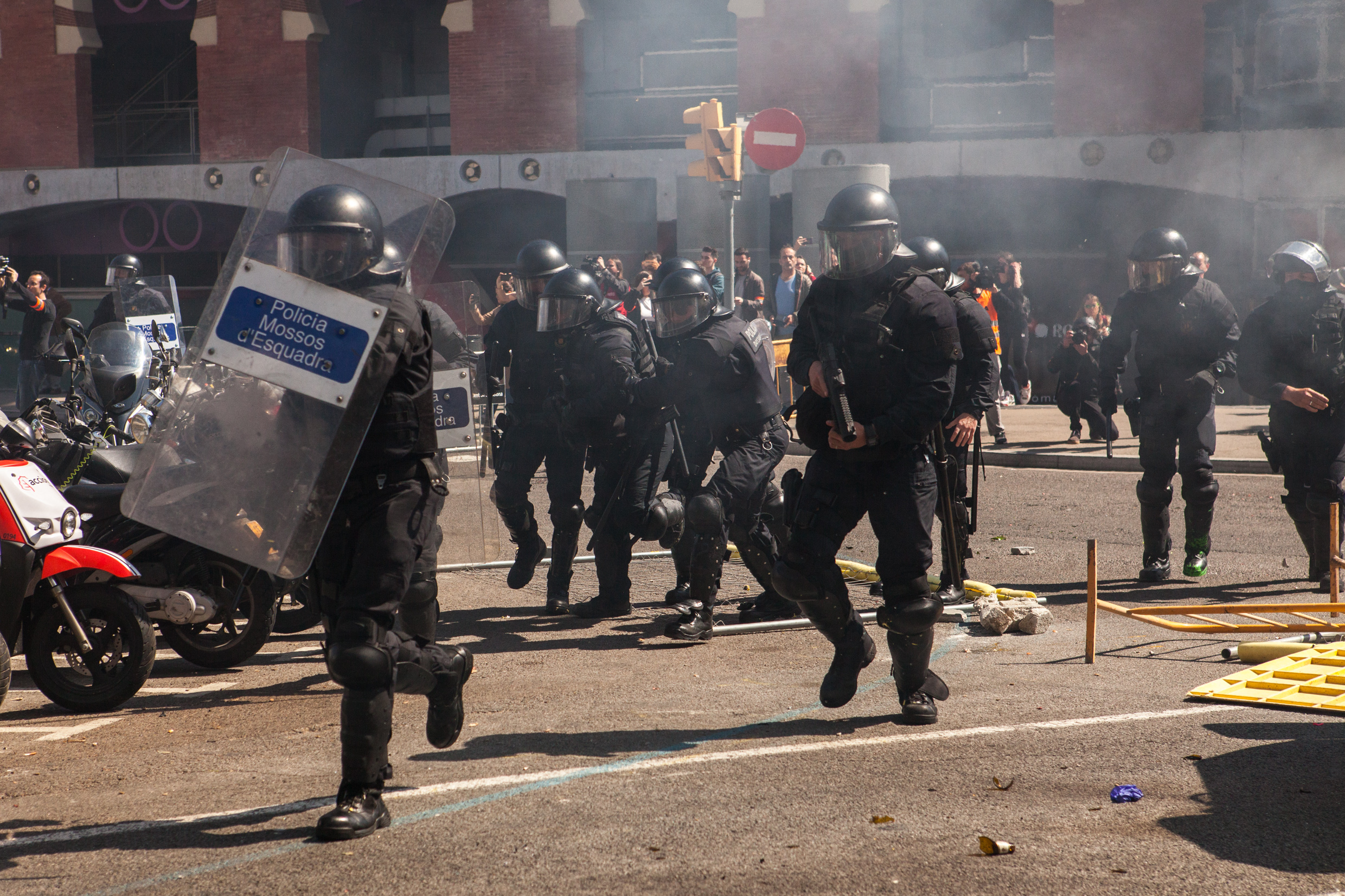 Catalan police charging the antifascist group. Barcelona