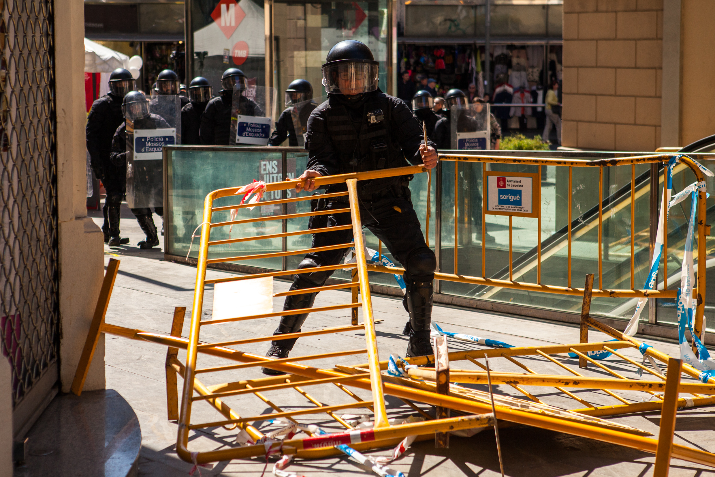Catalan police cleaning the way from the barricate to charge the antifascist group. Barcelona