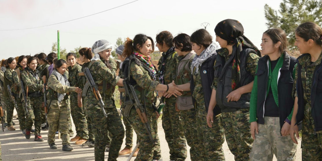 1920px-YPJ_fighters_shake_hands_with_one_another